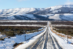 Empty snow road in The National Park Torres del Paine, Patagonia Royalty Free Stock Image