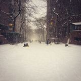 Empty Snowy Road. A snowy road in Manhattan with people playing Royalty Free Stock Images