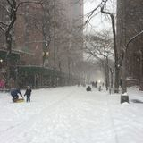 Empty Snowy Road. A snowy road in Manhattan with people playing Stock Photography