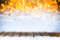 Empty snowy wooden planks christmas bokeh background stock image