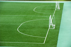 Empty soccer field. With goal posts and light poles Stock Photos