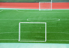 Empty soccer field. With goal posts and light poles Royalty Free Stock Image