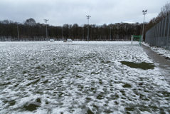 An empty soccer field. With some snow on it Stock Photo