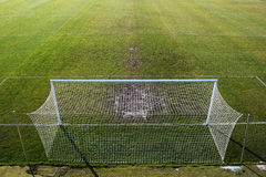 Empty soccer field and trampled grass near the gate. View from above Stock Images