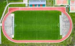 Empty Soccer Football Stadium with Green Grass and Running Lines. Royalty Free Stock Photo