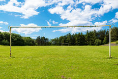 Empty soccer goal. Without a net on a great sunny summer day Stock Photos