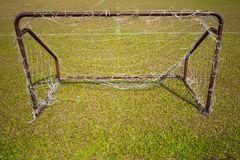 Empty soccer goal in sunny time Stock Photos