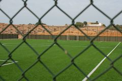 An empty soccer pitch viewed from outside the fence. stock photography