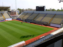 Empty soccer stadium 5. Empty soccer stadium with green grass being brushed Royalty Free Stock Photos