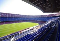 Empty soccer stadium. In a sunny day Stock Photos