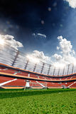 Empty soccer stadium in sunlight Royalty Free Stock Image