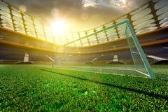 Empty soccer stadium in sunlight Stock Photos