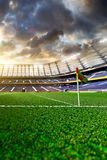 Empty soccer stadium in sunlight Royalty Free Stock Photos
