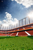 Empty soccer stadium in sunlight Stock Images