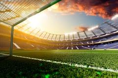 Empty soccer stadium in sunlight Stock Photo