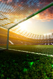 Empty soccer stadium in sunlight Stock Photography