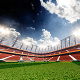 Empty soccer stadium in sunlight Stock Photos