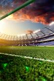Empty soccer stadium in sunlight royalty free stock photo