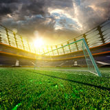Empty soccer stadium in sunlight Stock Photo