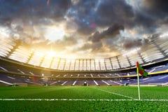 Empty soccer stadium in sunlight royalty free stock image