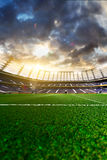 Empty soccer stadium in sunlight Royalty Free Stock Images
