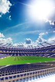 Empty soccer stadium in sunlight Royalty Free Stock Photos