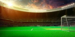 Empty soccer stadium in sunlight