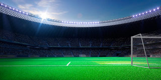 Empty soccer stadium in sunlight stock image