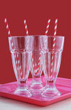 Empty soda pop glasses with straws. Royalty Free Stock Photography