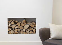 Empty Sofa with fire place behind. A modern living room stock photography