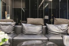 Empty sofa in living room at night, interior design stock photos
