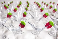 Empty sorbet cocktail glasses with jelly strawberry ready on edg. E. Closeup Stock Photography