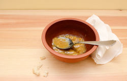 Empty soup bowl with breadcrumbs and a napkin Royalty Free Stock Photos