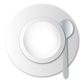 Empty Soup Bowl. A round empty soup bowl and silver spoon over a white background Stock Image