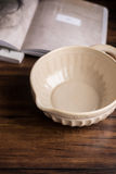 Empty soup bowl on a wooden rustic kitchen table Stock Photos