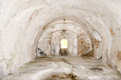 Empty space in abandoned fortres. An empty room of an old meditheranean castle Royalty Free Stock Images