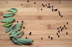 Empty space on the board with a bay leaf and black pepper Stock Photography