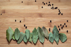 Empty space on the board with a bay leaf and black pepper Royalty Free Stock Photo