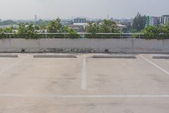 Empty space of car parking lot on rooftop floor of buildings. Stock Photos