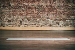 Empty space in fitness center, brick wall, natural wooden floor, modern loft studio, unrolled yoga mat on the floor. No people stock photo
