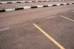 Empty space outdoor asphalt parking lot with white markings.  Stock Photos