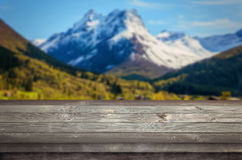 Empty space on a wooden table. Mountains in the background Royalty Free Stock Photography