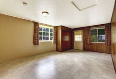Empty spacious entryway with wooden wall and tile floor. royalty free stock image