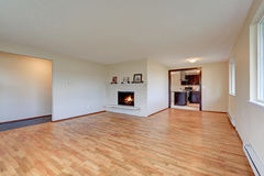 Empty spacious family room with fireplace Royalty Free Stock Photography