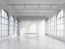 Empty spacious hall. With huge roman windows on two sides with Singapore view, three white boards on the concrete back wall, a wooden bench under them. Front Stock Photo