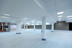 Empty spacious hall of office building. With artificial light sources Royalty Free Stock Photography