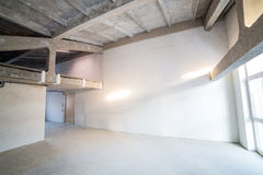 Empty spacious loft under construction Royalty Free Stock Photo