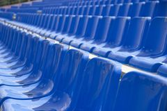 Empty spectator seats in the open-air arena stock image