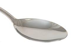 Empty Spoon on white background. Plain chrome soup spoon on white background, empty Stock Photo