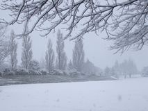 Empty sports ground blanketed with snow Stock Photography